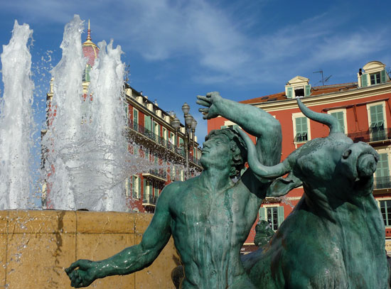 Sculpture of a man and a bull at the place Massena fountain in Nice